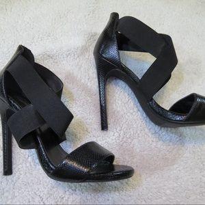 Black strapped heals